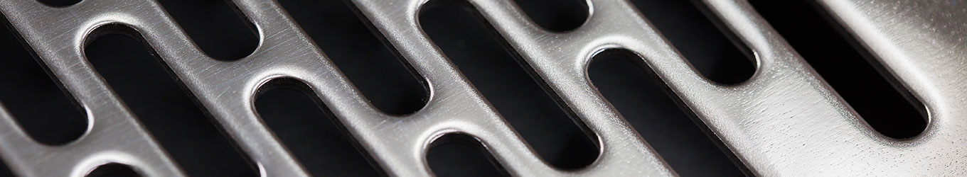 View of mirror polished sheet of metal as part of PCML's sheet metal fabrication services