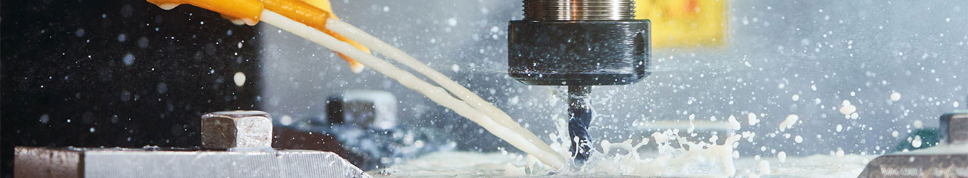 View of CNC mill machine in action with coolant to provide precision engineering solutions