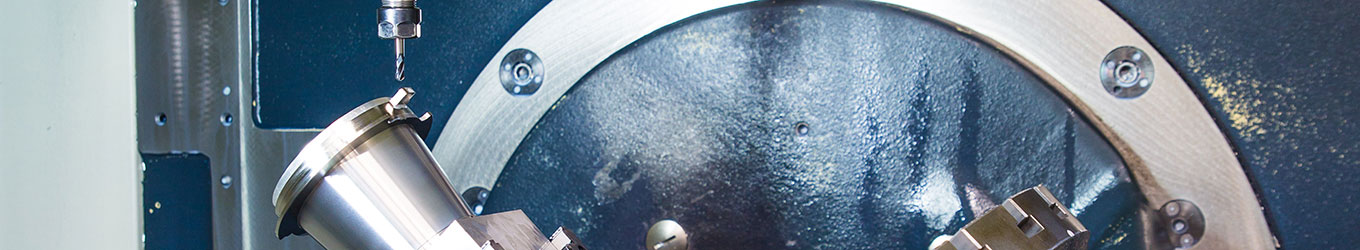 The banner for the Manufacturing page showing a zoomed in precision engineering component